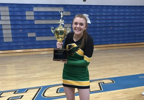 Kerinsa Haslip holding the trophy after the Lakeland cheer team wins the district competition in 2019 at Coeur d'Alene High School.