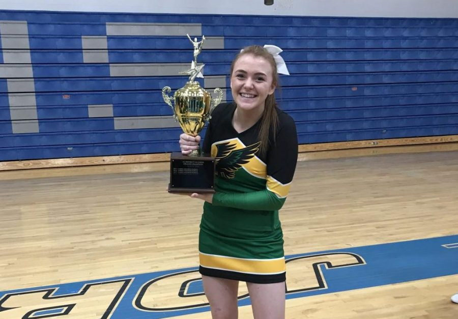Kerinsa+Haslip+holding+the+trophy+after+the+Lakeland+cheer+team+wins+the+district+competition+in+2019+at+Coeur+d%E2%80%99Alene+High+School.%0A