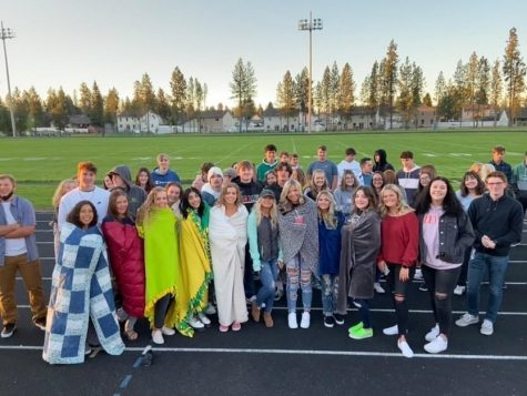 The 2021 senior class poses for a picture during the senior sunrise at the beginning of the year.