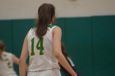 Katy Ryan standing focused on the basketball court.