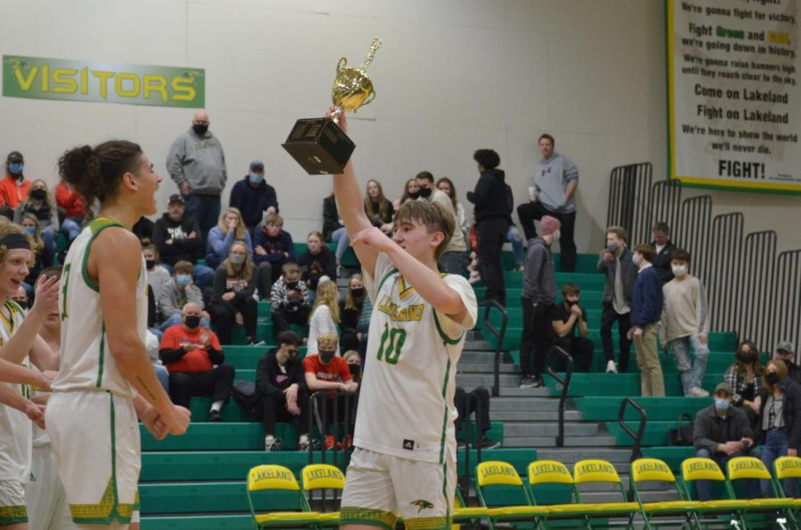Carson Seay hoist the trophy up in celebration