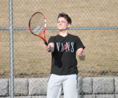 Darwin Porth serving his first serve in a practice tennis match. March 2nd 2021