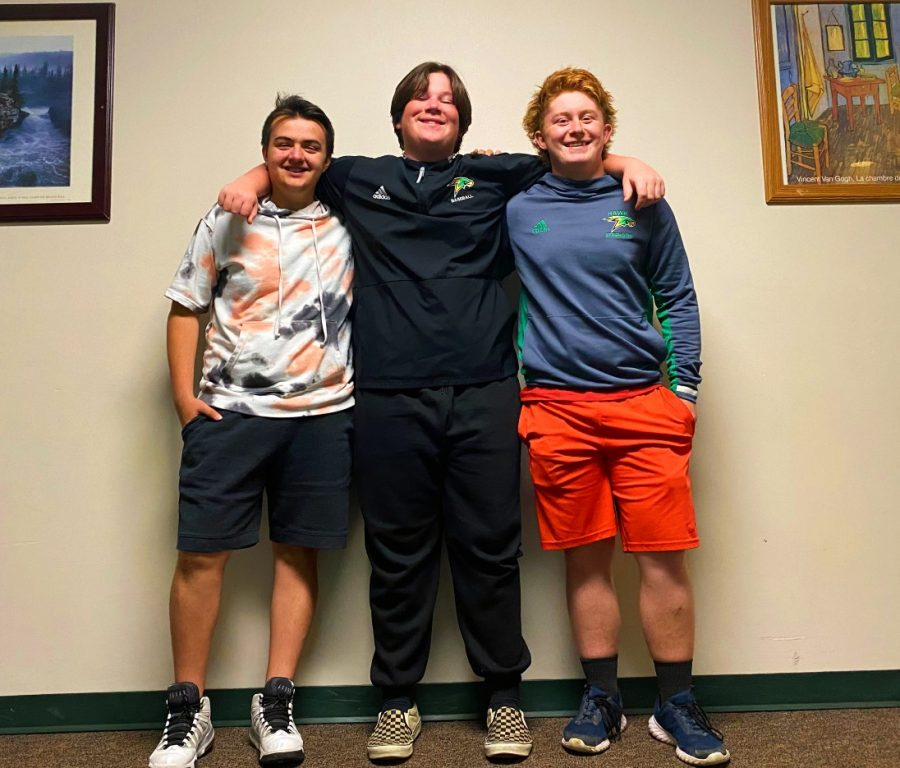 David, Liam, and Devon pose for a photo for a Year-In review.