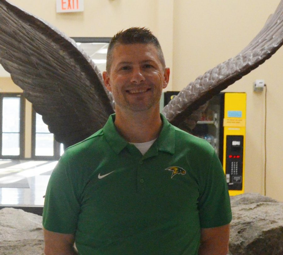 New Athletic Director Matt Neff standing in front of the hawk Statue at Lakeland High School.