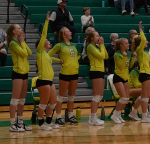 Lakeland Varisty Volleyball Team bench cheering on during play at Lakeland High School