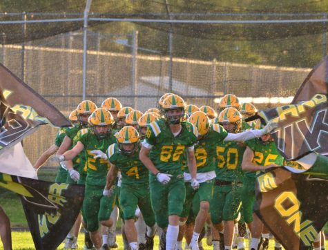 #88 Alden Waddington leads the Lakeland Hawks Varsity Football Team out to the field on August 27th at Lakeland High School.