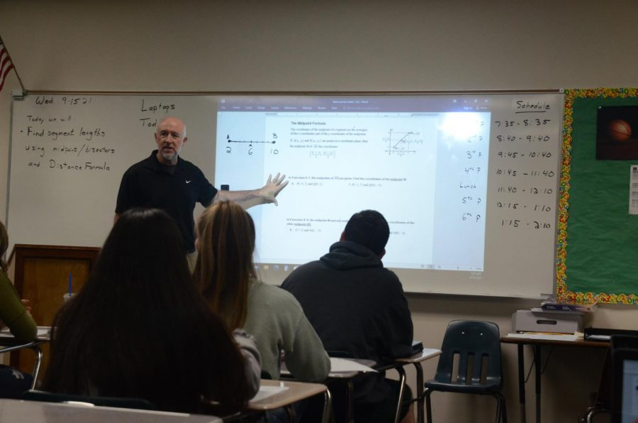 Geometry Teacher William Ryan up in front of the class teaching at Lakeland High School.
