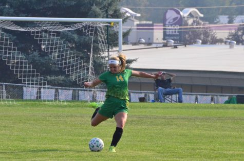 Caroline Gallus kicking the ball at Lakeland High School Soccer Field.