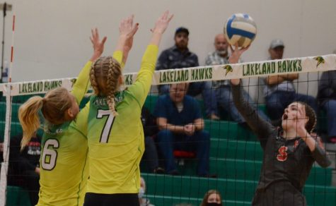 Addie Kiefer and Kenna Simon attempting to block Moscows hit.