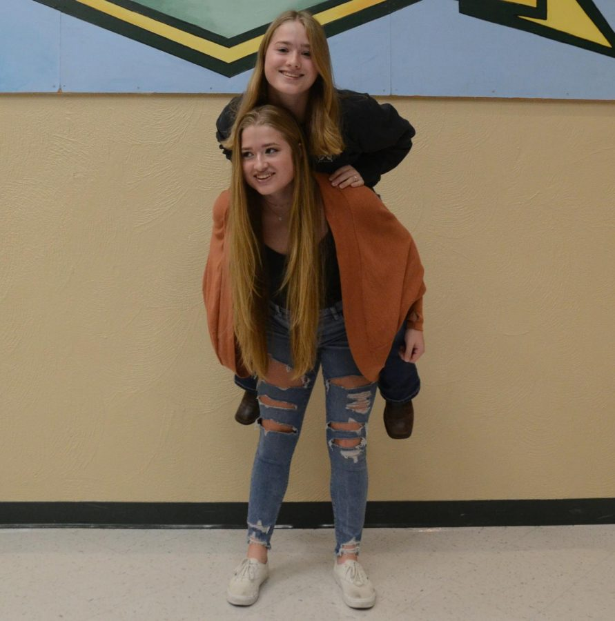 Makayla gives Mckenzie a piggy back ride as some of the most athletic twins in the school.